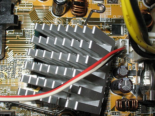 Carefully remove the dangling heatsink by unhooking